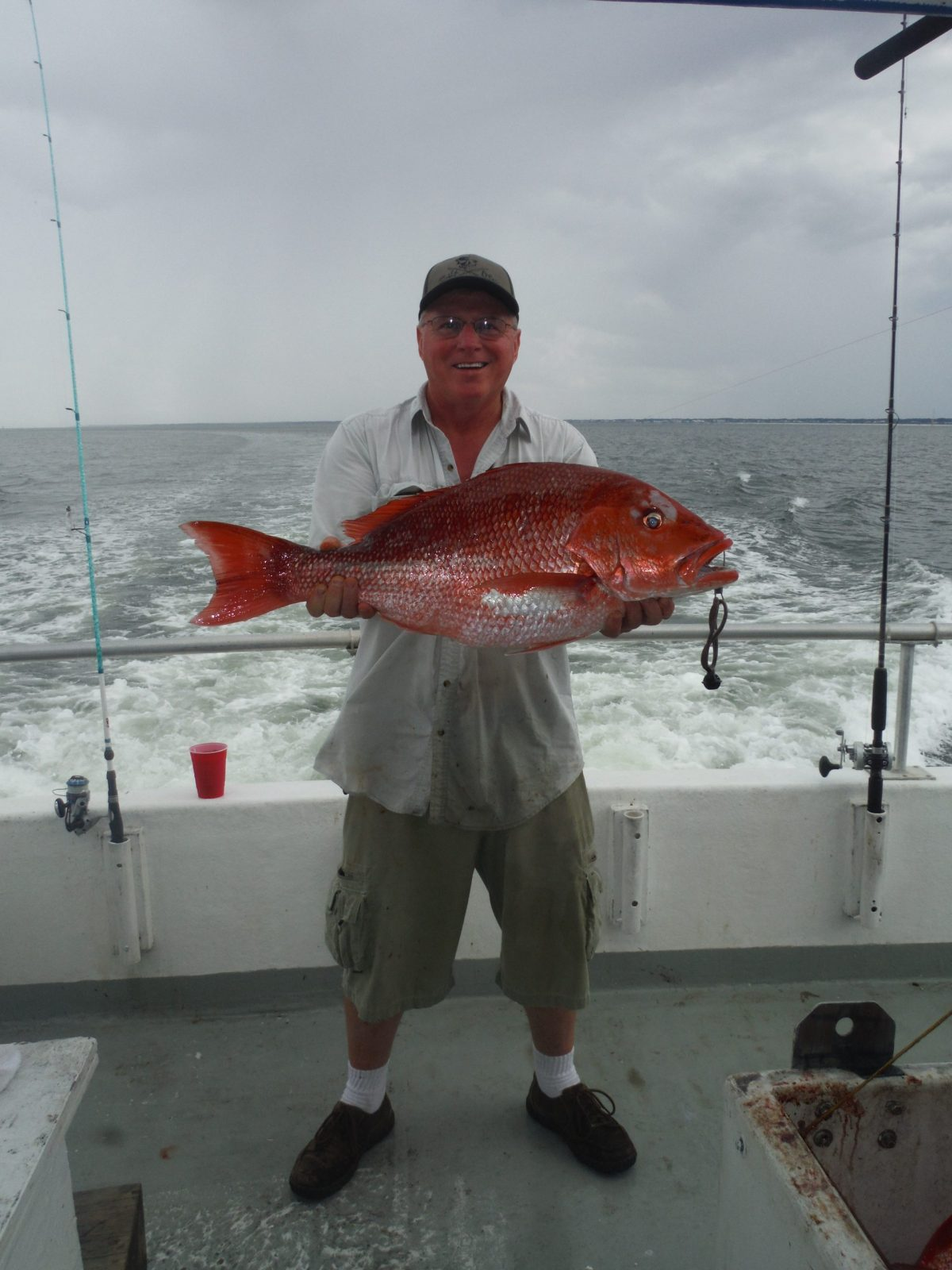 Man holding a red snapper